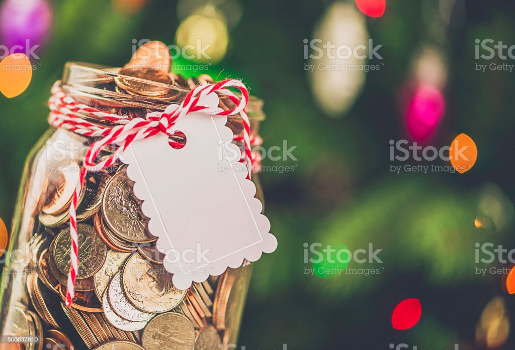 Christmas Charity Donation Jar Filled With American Currency Stock ...