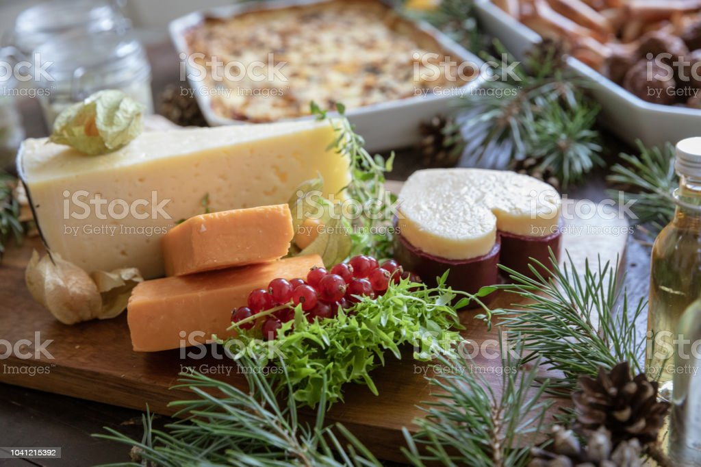 Christmas Cheese Platter.Christmas Cheese Platter On Table With Other Food Stock