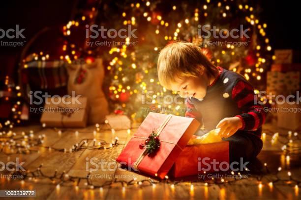 Christmas child open present gift happy baby boy looking to magic in picture id1063239772?b=1&k=6&m=1063239772&s=612x612&h= yeror29ihybvqmxhqkwslut36wwjajo nrqxj4zgco=
