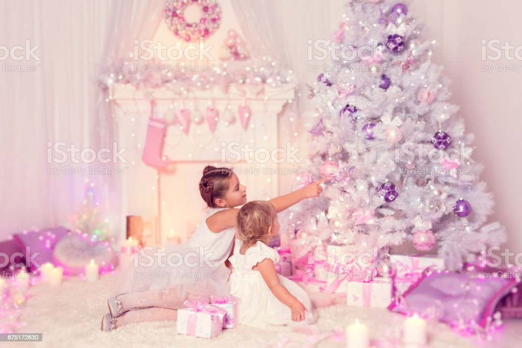 Christmas Children Decorating Xmas Tree Kid And Baby Girls In Holiday Family Home Stock Photo Download Image Now Istock