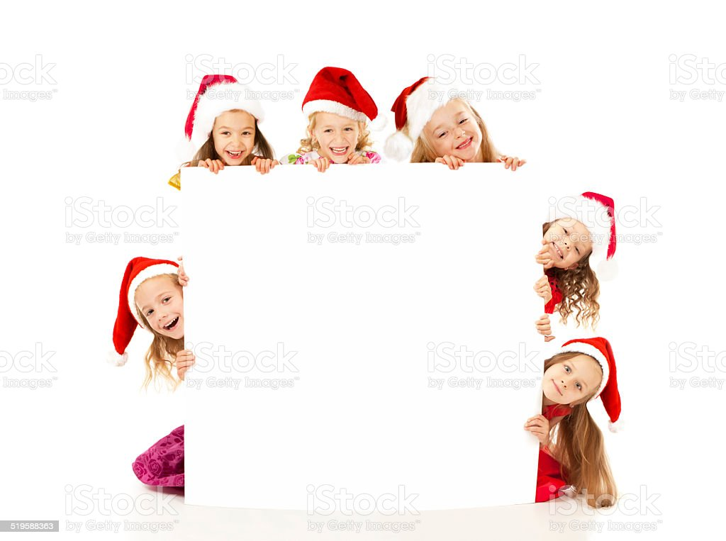 Christmas children with white banner stock photo