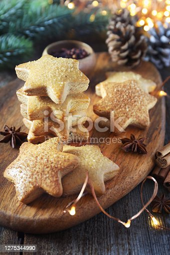Christmas cinnamon cookies (spice-cake) and New Year's decoration. Rustic style