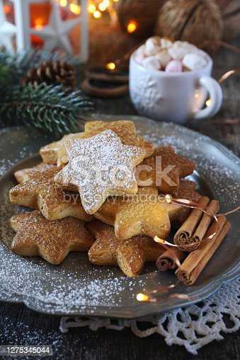 Christmas cinnamon cookies (spice-cake),  cup of coffee with marshmallows and New Year's decoration. Rustic style