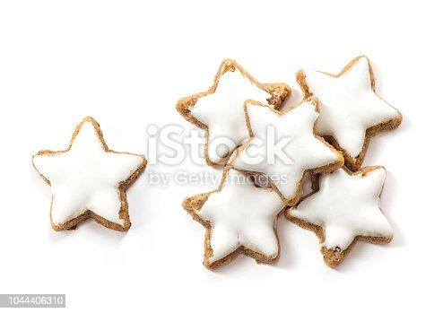istock Christmas cinnamon star cookies white background 1044406310