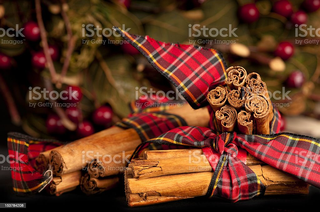 Christmas cinnamon sticks tied with a tartan ribbon stock photo