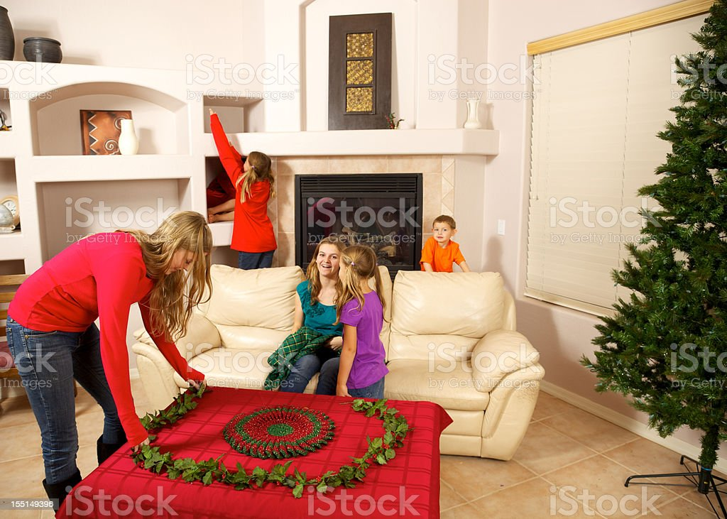 Christmas Cleaning and Decorating by Teens and Children stock photo