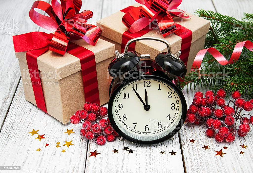 christmas clock on a  wooden background stock photo