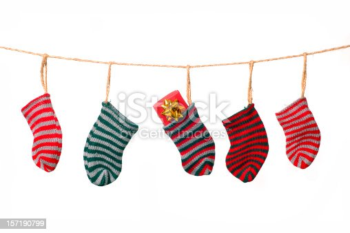 Christmas stockings hanging from a clothesline.