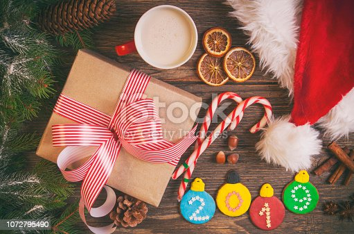 istock Christmas coffee and gingerbread cookies on rustic wooden table 1072795490