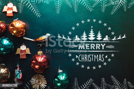 istock christmas collage with decoration on chalkboard and line illustration 609834726