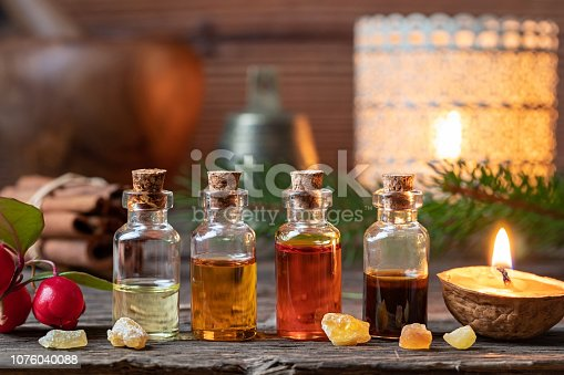 Christmas collection of essential oils with frankincense, wintergreen and candles