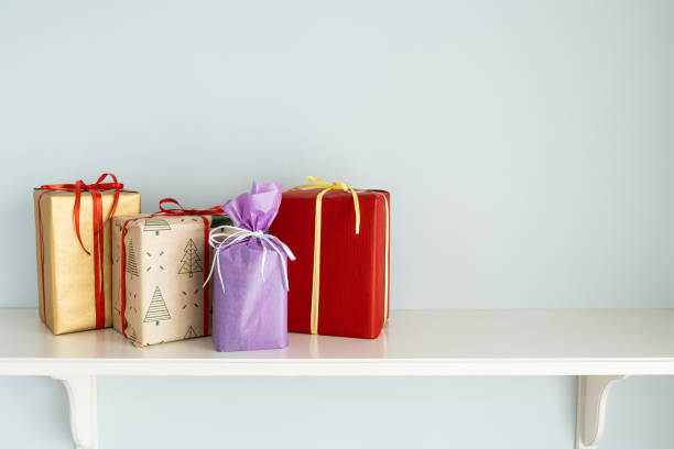 Christmas colorful gift boxes on the white shelf stock photo