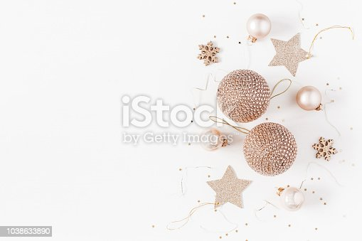 istock Christmas composition. Christmas balls, golden decorations on white background. Flat lay, top view, copy space 1038633890