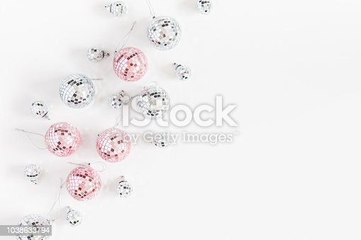istock Christmas composition. Christmas balls, pink and silver decorations on white background. Flat lay, top view, copy space 1038633794