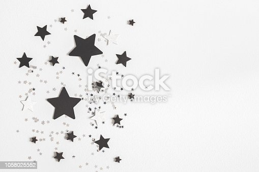 istock Christmas composition. Christmas black and silver decorations on pastel gray background. Flat lay, top view, copy space 1058025552
