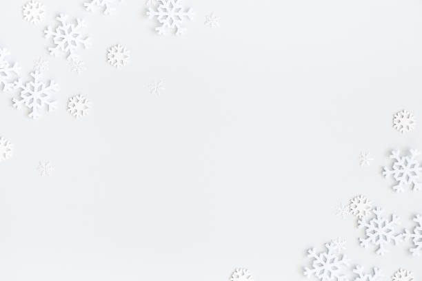 christmas composition. christmas frame made of snowflakes on pastel gray background. winter concept. flat lay, top view, copy space - snowflake background stock pictures, royalty-free photos & images