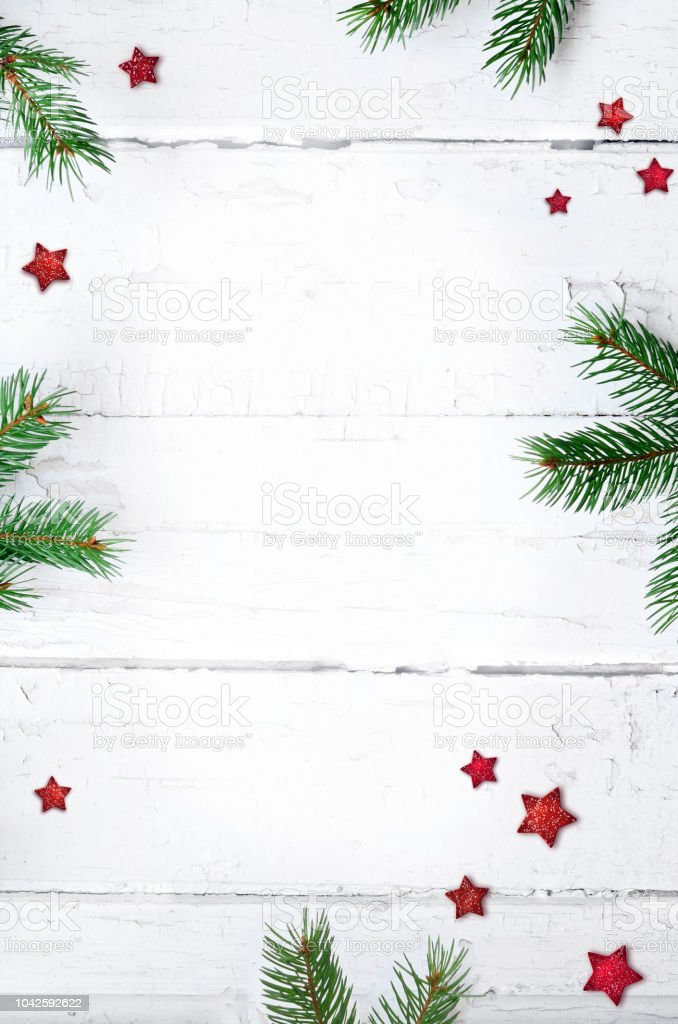 Christmas composition. Christmas gift, candy cane and fir tree branches. Top view, flat lay. royalty-free stock photo