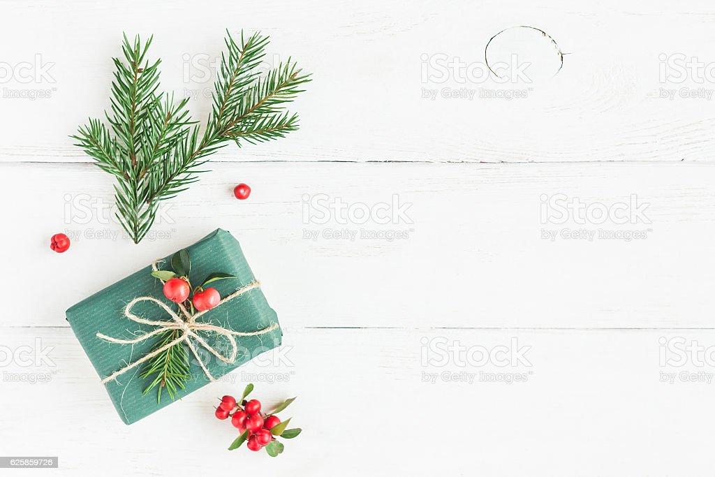 Christmas composition. Christmas gift, fir branches. Flat lay, top view stock photo