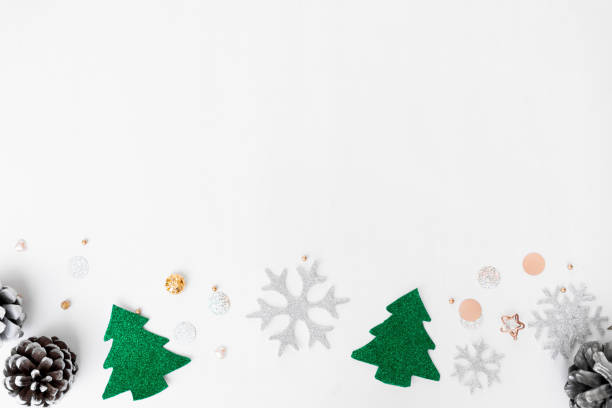 Christmas composition. Christmas gift, pine cones, fir branches on white background. Flat lay, top view stock photo
