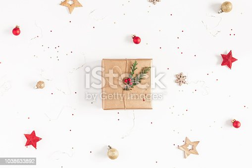 1060169304 istock photo Christmas composition. Christmas gifts, conifer branches, red and golden decorations on white background. Flat lay, top view, copy space 1038633892
