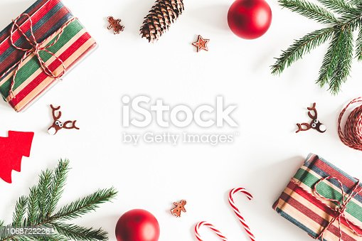 1074095098 istock photo Christmas composition. Christmas gifts, fir tree branches, decorations on white background. Flat lay, top view, copy space 1068722226