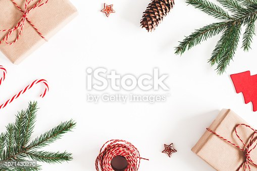 1076055746 istock photo Christmas composition. Christmas gifts, fir tree branches, decorations on white background. Flat lay, top view, copy space 1071430270