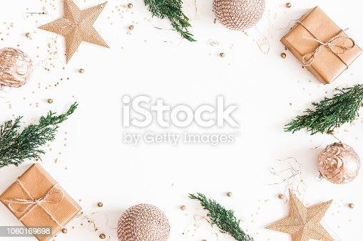 1060169304 istock photo Christmas composition. Christmas gifts, fir tree branches, golden decorations on white background. Flat lay, top view, copy space 1060169698
