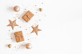 istock Christmas composition. Christmas gifts, golden decorations on white background. Flat lay, top view, copy space 1068721422