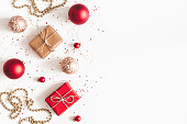 istock Christmas composition. Christmas gifts, red and golden decorations on white background. Flat lay, top view, copy space 1064021968