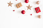 istock Christmas composition. Christmas gifts, red and golden decorations on white background. Flat lay, top view, copy space 1066865698