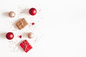 istock Christmas composition. Christmas gifts, red and golden decorations on white background. Flat lay, top view, copy space 1072909558