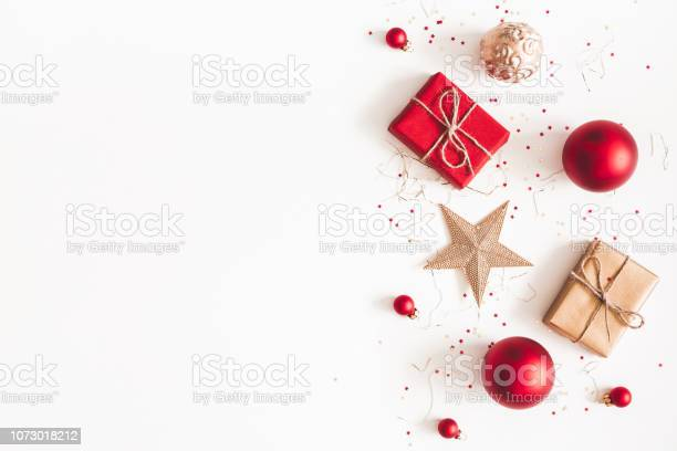 Christmas composition christmas gifts red and golden decorations on picture id1073018212?b=1&k=6&m=1073018212&s=612x612&h= pce4tc5dvizzegcuxv24esxexkmncn19 vbuuu4v5o=