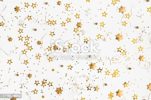 1076057502 istock photo Christmas composition. Christmas golden decorations on white background. Flat lay, top view, copy space 1179519609