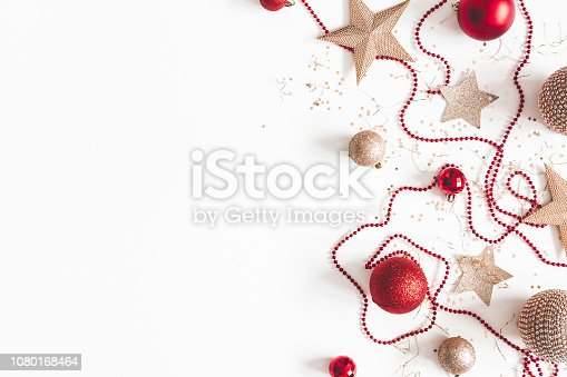 1076057502 istock photo Christmas composition. Christmas red and golden decorations on white background. Flat lay, top view, copy space 1080168464