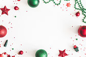 istock Christmas composition. Christmas red and green decorations on white background. Flat lay, top view, copy space 1074092506