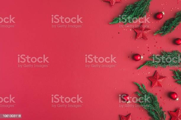 Christmas composition christmas red decorations fir tree branches on picture id1061303118?b=1&k=6&m=1061303118&s=612x612&h=ac3cahshpb2idbfb s3eyuydmggpoqinr1zphpbwhco=
