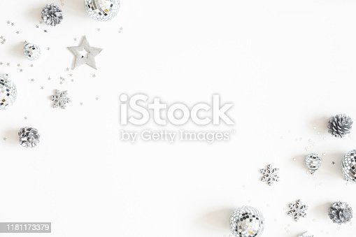 1076057502 istock photo Christmas composition. Christmas silver decorations on white background. Flat lay, top view, copy space 1181173379