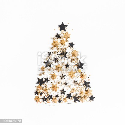 1074095098 istock photo Christmas composition. Christmas tree made of golden and black decorations on white background. Flat lay, top view, square 1064023278