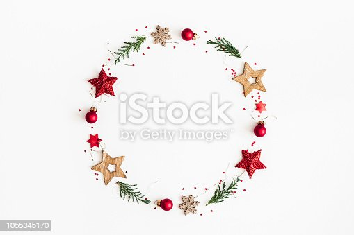 istock Christmas composition. Christmas wreath on white background. Flat lay, top view, copy space 1055345170