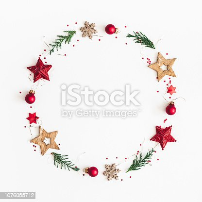 istock Christmas composition. Christmas wreath on white background. Flat lay, top view, copy space, square 1076055712