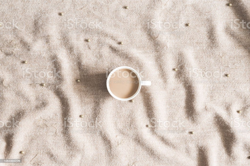 Christmas composition. Cup of coffee, plaid, christmas decorations. Flat lay, top view stock photo