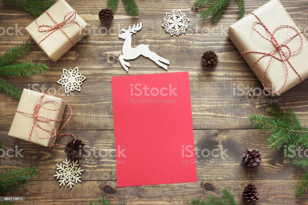 Christmas composition. Empty blank letter for Santa or your wishlist or advent activities. Top view and copy space. royalty-free stock photo