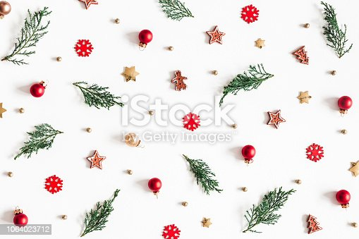 1064023690 istock photo Christmas composition. Fir tree branches, decorations on white background. Christmas, winter, new year concept. Flat lay, top view 1064023712