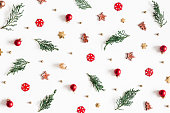 istock Christmas composition. Fir tree branches, decorations on white background. Christmas, winter, new year concept. Flat lay, top view 1064023712