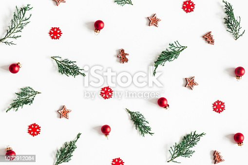 1076057502 istock photo Christmas composition. Fir tree branches, decorations on white background. Christmas, winter, new year concept. Flat lay, top view 1072912084