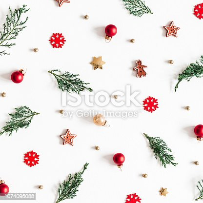 1074095098 istock photo Christmas composition. Fir tree branches, decorations on white background. Christmas, winter, new year concept. Flat lay, top view, square 1074095088