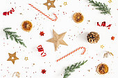 istock Christmas composition. Fir tree branches, golden and red decorations on white background. Christmas, winter, new year concept. Flat lay, top view 1181172352