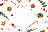 istock Christmas composition. Fir tree branches, golden and red decorations on white background. Christmas, winter, new year concept. Flat lay, top view, copy space 1183035020
