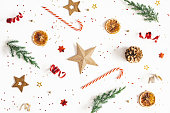 istock Christmas composition. Fir tree branches, golden and red decorations on white background. Christmas, winter, new year concept. Flat lay, top view 1283451191