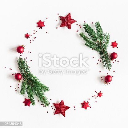 1060169304 istock photo Christmas composition. Fir tree branches, red and green decorations on white background. Christmas, winter, new year concept. Flat lay, top view, copy space, square 1074394346